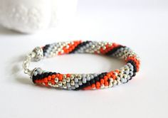 Items similar to Red striped rope bracelet. Beaded tube bangle in red, black, grey and silver. Summer bangle with stripes on Etsy Bangles, Beaded Bracelets, Bead Crochet Rope, Handmade Items, Handmade Gifts, Red Black, My Etsy Shop, Trending Outfits, Beads