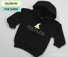 Shop for glow in the dark clothing on Etsy, the place to express your creativity through the buying and selling of handmade and vintage goods. Halloween Party Costumes, Halloween Birthday, Halloween Gifts, Dark Witch, Trick Or Treat Bags, Personalized Baby Gifts, Halloween Design, Black Hoodie, Jumper