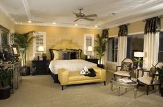 Cheerful bedroom design in yellow, white and earth tones.  Florida dream home bedroom for sure!!