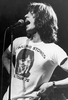 Mick Jagger performs in a vintage Rolling Stones t-shirt from 1975