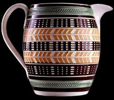 Mochaware - Pearlware barrel form jug. Pattern cut through slip bands with two different knives between bends of green glazed herringbone and beads rouletting, ca. 1820.