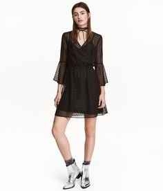 Check this out! Dress in airy, glittery plumeti chiffon with a wrapover bodice, long sleeves with flounce at cuffs, and elasticized seam at waist. Lined with attached jersey liner dress. - Visit hm.com to see more.