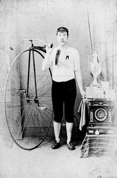 Cyclist with trophies beside his penny-farthing bicycle. | Flickr - Photo Sharing!