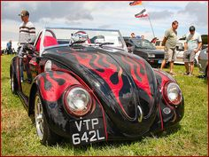 vw beetle red and black with flames convertible