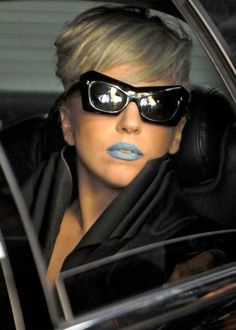 Lady Gaga actually looks half way normal except the blue lips which is slight compared to what she usually wears.