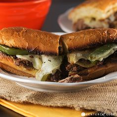 Slow Cooker French Dip Sandwiches with caramelized onions and peppers made in the slow cooker with au jus on the side for dipping. This is an easy dinner your whole family will love!