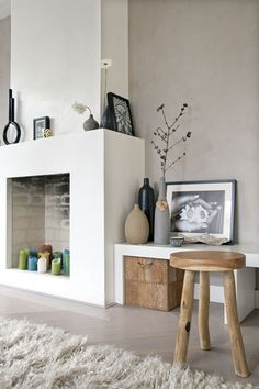 """""""A sleek contemporary room design in concrete gray and white is warmed-up with natural accessories and a large shaggy rug."""""""