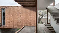 Mezquites House by AS/D Asociación de Diseño | Clay brick and concrete Mexican house surrounds a cactus tree