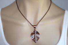 Copper leaf pendant.