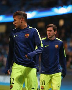 Neymar and Lionel Messi of Barcelona warm up during the UEFA Champions League Round of 16 match between Manchester City and Barcelona at Etihad Stadium on February 24, 2015 in Manchester, United Kingdom.
