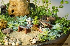 """Grandma's Garden is done!  Here is a preview shot, showing the bench, pagoda lantern, pots and rake I made from polymer clay.  I found the rock laying around and stained it with wood stain then Valspar Satin finish.  For scale, the pagoda is just over 1 inch tall, and the pot is 12"""" across."""