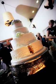 Another close up of our wedding cake from Ambrosia Bakery in Baton Rouge: ivory buttercream with scrolls