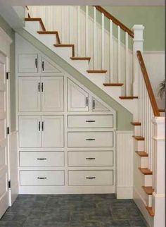 Basement Stairs Storage upselling with kitchen storage built-ins | wine cellars, drawers