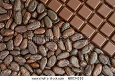 Bar of chocolate and cocoa beans - stock photo