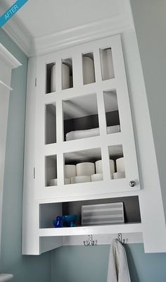 extra bathroom storage - built in cabinet above the toilet