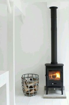 """42 Lovely Scandinavian Fireplace To Rock This Year. A stone fireplace design your pioneer ancestors would envy is the """"Multifunctional Fireplace. Stove Fireplace, Fireplace Remodel, Living Room Decor Cozy, Interior Design Living Room, Living Rooms, Scandinavian Fireplace, Installing A Fireplace, Stone Fireplace Designs, Rock Fireplaces"""