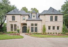 This chateau house plan defines neoclassical architecture.  Entering the foyer you will find the family living area.