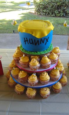 Simple cupcakes and maybe a small cake for the top but instead of a honey pot a simple cake with classic Pooh and Eeyore