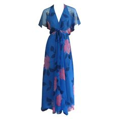 1970s ESTEVEZ Floral Print Maxi Dress | From a collection of rare vintage evening dresses at https://www.1stdibs.com/fashion/clothing/evening-dresses/