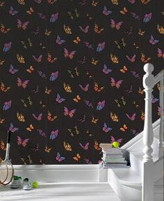 Colourful butterfly wallpaper makes for a dramatic entryway