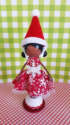 """Stacy Elf Christmas Miniature Wooden by SugarlandDollHouse on Etsy- """"Stacy"""", a super cute wooden clothespin doll stands just over four inches tall, and is uniquely hand painted in vibrant colors and wears a real cotton dress with tulle underskirting."""