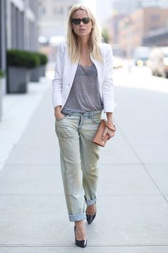 Street Style New York Fashion Week SS13:blogger Elin Kling in a masculine-inspired look.Semi-transparent top + acid wash 'boyfriend' jeans + white blazer.Cat-eye sunglasses,camel clutch and black patent leather heels complete her outfit.