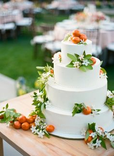 I love the concept of decorating a white tiered cake with natural elements like fruits & leaves. The juxtaposition between earthiness & formality is great.