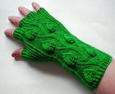 Half-fingered gloves with an elegant pattern of leaves running up the back of the wrist and hand. Ribbed on the palm to fit most hand sizes and available in both a short and long version.