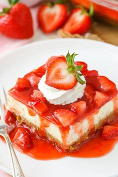 ***Easy Strawberry Cheesecake ~ thick crust, creamy vanilla cheesecake and a homemade strawberry topping!