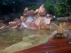 Large Feature Pond and Waterfall. Sandstone Boulders, Cascading Waterfall, Decking, Sandstone Seats, Garden Lights, Modern Garden Water Feature Sydney. Northern Beaches Water Feature Landscape Garden Design
