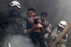 Men free a boy from rubble after explosive barrels were dropped by forces loyal to Syria's President Bashar Al-Assad in the Al-Shaar neighborhood of Aleppo. (REUTERS/Hosam Katan)