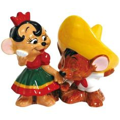 These super cute mice make up this Mexican themed wedding cake topper with Speedy Gonzales planting a smooch on Senorita Mouse.  *Please note these are salt and pepper shakers; they will have small holes on their heads, and magnets in their sides. They look very cute on the top of a cake!