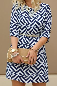 gold accessories // geometric print... I love seeing clothes I have in my closet on Pinterest!