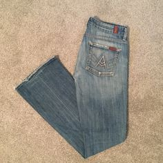 7 for all Mankind boot cut jeans 7 for All Mankind boot cut jeans. Frayed detailing on knees. So comfortable!! Size 27 7 for all Mankind Jeans Boot Cut