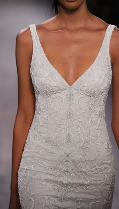 Ivory beaded and embroidered net slip bridal gown over cashmere chiffon, V neckline front and back, horsehair accent at hem, chapel train.