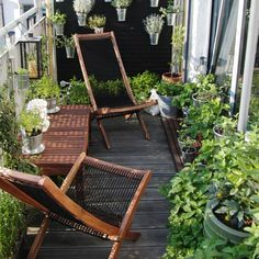 Pain planks of wood black, line them along one edge of balcony, blocks sun & create backdrop for hanging pots