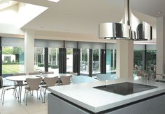 The curves of the dramatically styled Double Vertigo extractor hood from BEST create a focal point in the kitchen.
