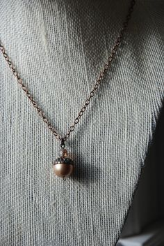 "Woodland Treasures $13 A simple and fun acorn 18"" necklace made with antiqued brass and Swarvoski beads.  *Keep out of reach from small children. Choking hazard."