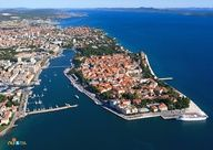 Zadar is an ancient Mediterranean port city. The old town, surrounded by walls and towers on a peninsula, with a new, urban part is connected by a bridge, a symbol of the city.