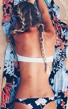 Beautiful long blonde hair. French braids