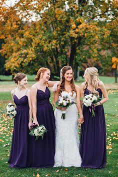 Bridesmaids wearing long, plum gowns for a Wonderfully Woodsy Winter Wedding in Purple and Green - Ctg Photography http://www.confettidaydreams.com/winter-woodsy-wedding-purple-green/