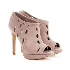 Platform ankle bootie with cut out details and zip up back.