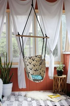 Indoor Hammock Chair DIY Awesome. Kids would be arguing over who gets to sit and read in it.... maybe I can convince my boyfriend to put two up in the basement tv room??!!