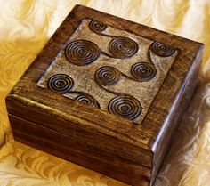 Carved wooden box. This is a set of two nesting boxes that my husband found for $3 at last weekends garage sale. They look great on his dresser.