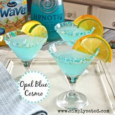 Opal Blue Cosmo with Hypnotiq is a sky blue cosmopolitan. It has lime, orange, cranberry juices with Hypnotiq taking center stage. Refreshing and gorgeous.