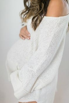 Gorgeous off the shoulder maternity sweater. Pregnancy is so beautiful.