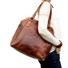 This large brown handbag tote is crafted from beautiful oiled leather which gives each bag its authentic vintage finish. Large enough for books, iPad/laptop this bag is perfect for work or college. There is one main compartment inside a handy front pocket which closes with a magnetic