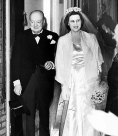Mary accompanied by her father, Winston Churchill, on the day of her wedding to Christopher Soames in 1947