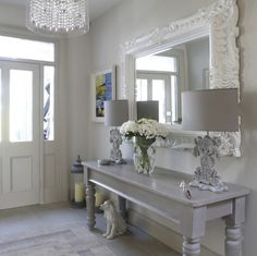 grey and white entryway idea like the use of multiple textures