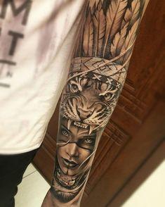 Tatuagem criada por Samurai Standoff do Rio Grande do Sul. India com toca de tigre e cocar no braço em preto e cinza.
